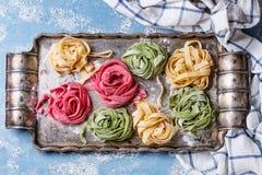 Colored fresh homemade pasta tagliatelle Stock Photos