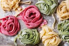 Colored fresh homemade pasta tagliatelle Royalty Free Stock Photos