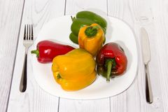 Colored Fresh paprika on the plate Royalty Free Stock Images