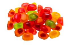 Colored fruit jelly beans on white background stock photos