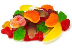 The colored fruit jelly sweets. On white background Royalty Free Stock Photos