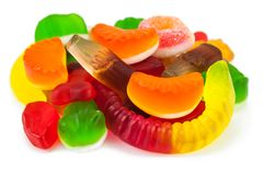 The colored fruit jelly sweets. On white background Stock Image