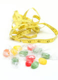 The colored fruit taste candies. and tape measure .sweet food concept Stock Photography