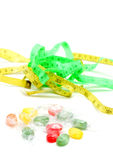 The colored fruit taste candies. and tape measure .sweet food concept Royalty Free Stock Photography