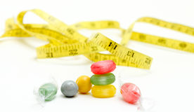 The colored fruit taste candies. and tape measure .sweet food concept Stock Image
