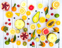 Colored fruits on white wooden background Royalty Free Stock Image