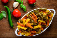 Colored Fusilli Doppia Rigatura Pasta with Cooking Ingredients Royalty Free Stock Photo