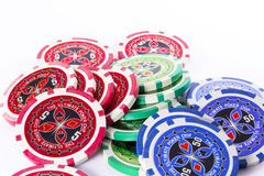 Colored gambling chips poker. A colored gambling chips poker over white background Royalty Free Stock Image