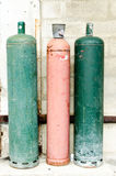 Colored gaz bottles in the street Stock Photography
