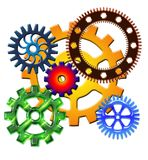 Colored gears on white background. Various sized colored gears interconnecting on white background Stock Photography