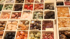 Colored gemstones. Gemstones of different colors and shape for sale stock video