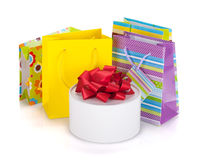 Colored gift bags and box Royalty Free Stock Photos