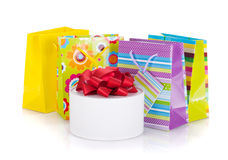 Colored gift bags and box Stock Photography