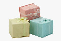 Colored gift boxes. Three colored small gift boxes with white background royalty free stock image
