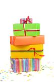 Colored gift boxes. Stack of colored gift boxes and confetti Stock Photo