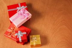 Colored gift boxes with decorative bows. Selective focus Stock Photo