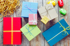 Colored gift boxes on wooden background with ribbons Royalty Free Stock Photos
