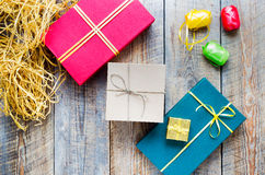 Colored gift boxes on wooden background with ribbons Royalty Free Stock Photography