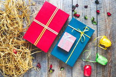 Colored gift boxes on wooden background with ribbons Stock Photography