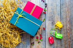 Colored gift boxes on wooden background with ribbons Royalty Free Stock Photo
