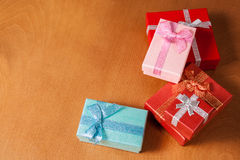 Colored gift boxes  on wooden background. Selective focus Royalty Free Stock Photos