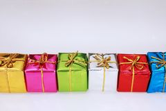 Colored gifts. Row of colorful gifts isolated on white, yellow, pink, green, silver, red and blue Stock Images