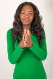 The colored girl is clapping Stock Image