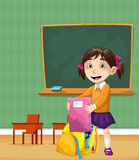 Colored  of a girl in a classroom. Hand drawn happy studious girl in a classroom coloring page for kids Stock Images
