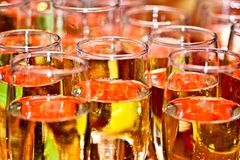 Colored glass. Fizz in glass, orange color Stock Images
