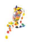 Colored glass beads. In small glass. Isolated comosition Stock Photography