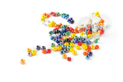 Colored glass beads. In small glass. Isolated comosition Stock Photos