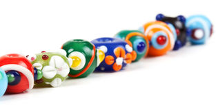 Colored glass beads hand Royalty Free Stock Images
