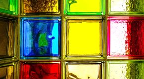Colored glass blocks. Colorful glass blocks panel for background pattern. stock images