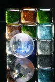 Colored glass blocks and globe royalty free stock photography