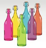 Colored glass bottles Stock Images