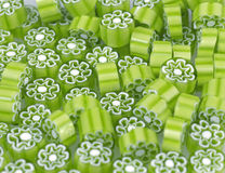 Colored glass flowers. Green and white flower pattern venetian millefiori glass beads Stock Image