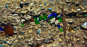 Colored glass. Fragments of colored glass on concrete Royalty Free Stock Photo