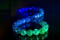 Colored glass marbles , infinity symbol on dark background. Colored glass marbles , infinity symbol on dark stock photo
