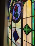 Colorful glass pane of church window royalty free stock image