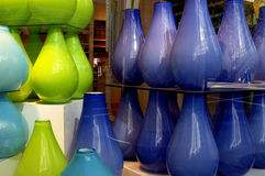 Colored Glass Vases. In store window stock images