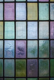 Colored glass window with block pattern background Stock Photography