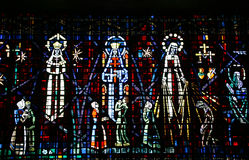 Colored glass window in the church of Notre Dame d Stock Images