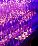 Colored glasses. Wine glasses in colored light royalty free stock photography