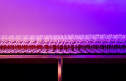 Colored glasses. Wine glasses in colored light Royalty Free Stock Photo