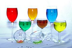 Colored Glasses. Colorful Celebration of Stem Glasses in various positions Stock Images