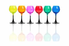 Colored glasses. Colored glasses stand in a row on a white background royalty free stock image