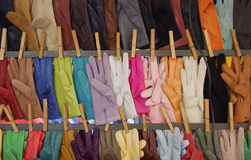Colored glaves on a sale. Leather gloves on sale in Rome Stock Photo