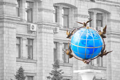 Colored globe over facade administrative house Royalty Free Stock Photos