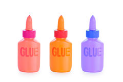 Colored glue bottles. Set of colored glue bottles isolated on white background with clipping path Royalty Free Stock Photos