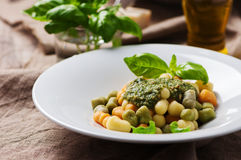 Colored gnocchi with pesto Stock Photography